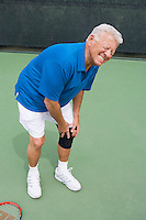 Tennis player suffering from knee injury