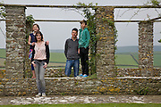 Baker family in the rose arbour at Pickwell Manor. From left to right: Liza Baker (9), Susannah Baker, Steve Baker, Zac Baker (11). Pickwell Manor, Georgeham, North Devon, UK.<br /> CREDIT: Vanessa Berberian for The Wall Street Journal<br /> HOUSESHARE