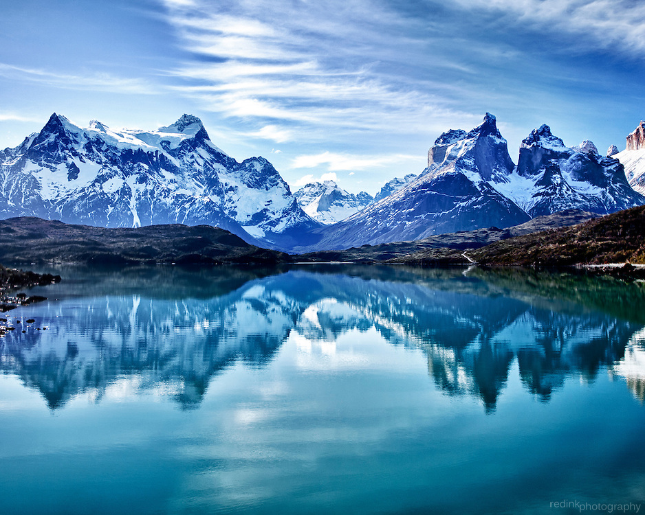 Cerro Paine Grande and the Cuernos del Paine are reflected in the turquoise waters of Lago Penhoe in Torres Del Paine National Park. Chile. Patagonia.