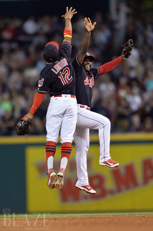 Sep 2, 2016; Cleveland, OH, USA; Cleveland Indians shortstop Francisco Lindor (12) and left fielder Abraham Almonte (35) celebrate the Indians 6-2 win over the Miami Marlins at Progressive Field. Mandatory Credit: Ken Blaze-USA TODAY Sports