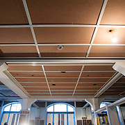 """February 27, 2013 - New York, NY : American chef and restaurateur Andrew Carmellini plans to open """"Lafayette,"""" an expansive French restaurant and bakery, at 380 Lafayette Street in NoHo, in April. Pictured here, the columns bear blue, yellow, and ochre tiles and the ceiling has been lined with cork to give the space warmth, and to dampen sound. CREDIT: Karsten Moran for The New York Times"""