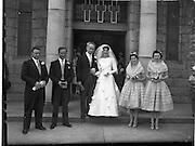 30/06/1959<br /> 06/30/1959<br /> 30 June 1959<br /> Wedding of James Hendron, Derrykeerin, Portadown and Miss Eileen McCabe, 9 Maretimo Terrace, Blackrock at St. Patrick's Church, Skerries, Co. Dublin. Picture shows the Bridal Party (l-r): Mr Seamus Bellew, (Cousin of Groom) Groomsman; Mr. Patrick Hendron, (Brother of Groom) Best Man; The Bride and Groom; Miss Lila Halligan, (cousin of Bride) and Miss Mary McSparren, Bridesmaids.