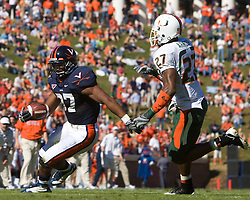 Virginia running back Cedric Peerman (37) in rushes against Miami.  The Virginia Cavaliers faced the Miami Hurricanes in a NCAA football game at Scott Stadium on the Grounds of the University of Virginia in Charlottesville, VA on November 1, 2008.Miami defeated Virginia 24-17 in overtime.