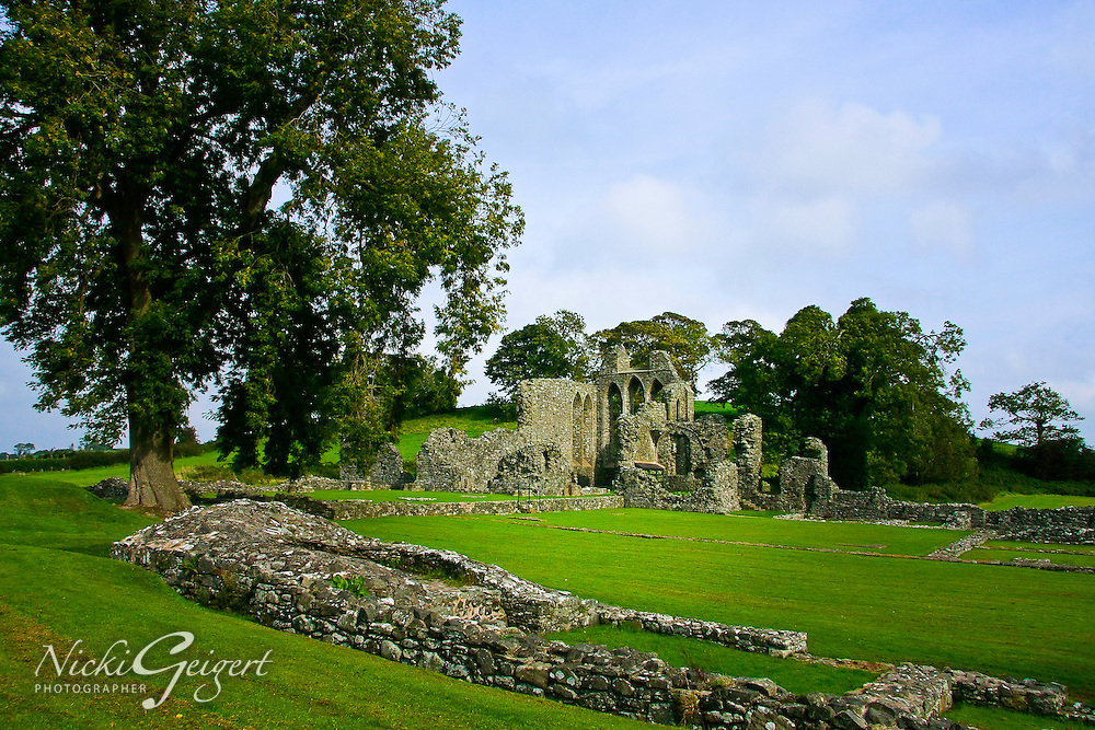 Old Ruins of a cathedral in a field against a blue sky, architecture, Ireland. Exotic places wall art. Fine art photography prints for sale. Stock image.