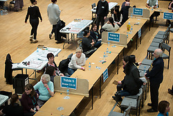 © Licensed to London News Pictures . 03/12/2015 . Oldham , UK . Ballot counters . The count at the Oldham West and Royton by-election , at the Queen Elizabeth Hall in Oldham . The by-election was called following the death of MP Michael Meacher . Photo credit: Joel Goodman/LNP