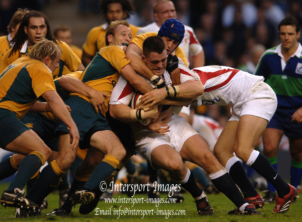 2005 Rugby, Investec Challenge, England vs Australia, Andrew Sheriden, on the roll, Wallabies left to right tackling, Phil Waugh, Chris Whitaker and Nathen Sharpe.  RFU Twickenham, ENGLAND:     12.11.2005   © Peter Spurrier/Intersport Images - email images@intersport-images..