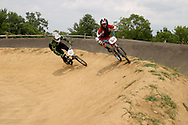 Tyler 'twitch mcnasty' Lawson (60) of Jamestown and Alex Burger (364) of Kettering during the American Bicycle Association Kettering BMX single races at Delco Park in Kettering, July 1, 2012.