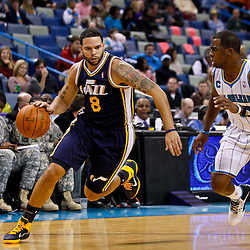 December 17, 2010; New Orleans, LA, USA; Utah Jazz point guard Deron Williams (8) drives past New Orleans Hornets point guard Chris Paul (3) during the first half at the New Orleans Arena.  Mandatory Credit: Derick E. Hingle