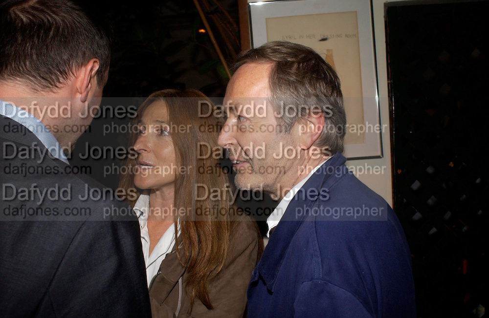 Tricia and Terry Jones. Dinner at San Lorenzo, Beauchamp Place after Tod's hosts Book signing with Dante Ferretti celebrating the launch of 'Ferretti,- The art of production design' by Dante Ferretti. 19 April 2005.  ONE TIME USE ONLY - DO NOT ARCHIVE  © Copyright Photograph by Dafydd Jones 66 Stockwell Park Rd. London SW9 0DA Tel 020 7733 0108 www.dafjones.com
