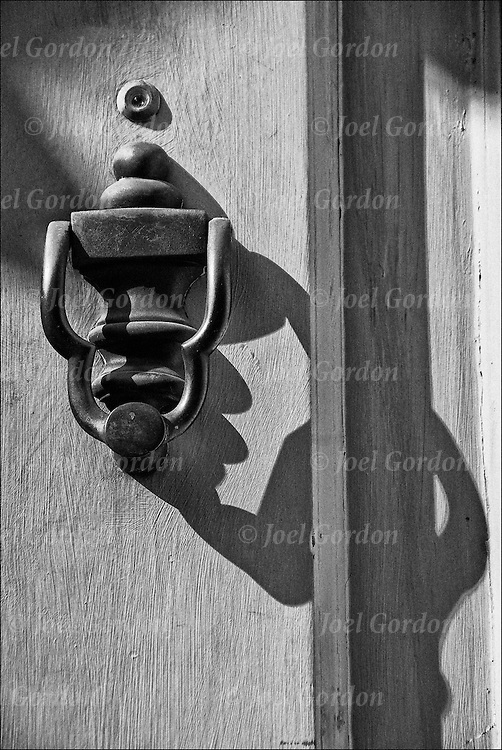 Decorative and functional brass door knocker.<br /> <br /> Originally, doorknockers were signage for a home, which indicated one's profession.