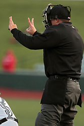 16 May 2014:   Umpire David Fields shows the count during a Frontier League Baseball game between the Evansville Otters and the Normal CornBelters at Corn Crib Stadium on the campus of Heartland Community College in Normal Illinois