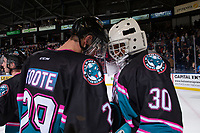 KELOWNA, CANADA - NOVEMBER 3:  Nolan Foote #29 congratulates Roman Basran #30 of the Kelowna Rockets on the win against the Brandon Wheat Kings on November 3, 2018 at Prospera Place in Kelowna, British Columbia, Canada.  (Photo by Marissa Baecker/Shoot the Breeze)