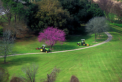 Stock photo of an aerial view of tractors mowing the grass at Buffalo Bayou Park
