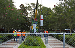 June 20, 2017 - Orlando, FL, USA - Workers disassemble the ''Johnny Reb'' Confederate memorial statue at Lake Eola Park on Tuesday morning, June 20, 2017. The statue will later be reassembled at Greenwood Cemetery. (Credit Image: © Jacob Langston/TNS via ZUMA Wire)