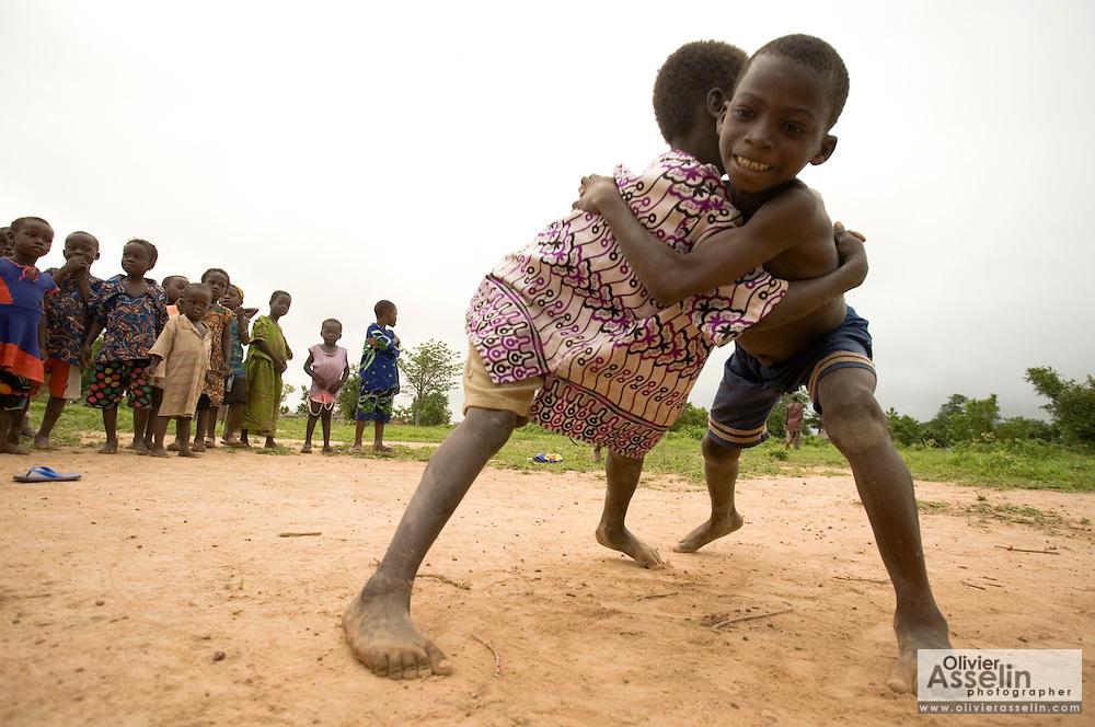 Boys wrestle outside the Kotonli kindergarten in the village of Kotonli, northern Ghana, on Thursday June 7, 2007..