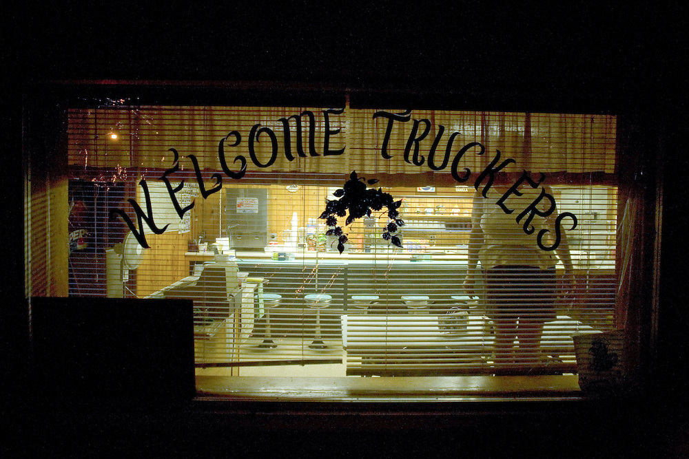 Ledonna, the owner of the Sand Cafe, stands inside the window. Highway 20, Merriman, Cherry County, Nebraska, 8/30/2007 Photo by Ben Depp