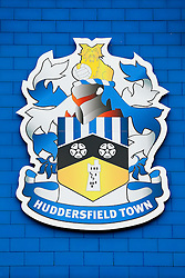 A Huddersfield club crest on the outside of the John Smith's Stadium - Photo mandatory by-line: Rogan Thomson/JMP - 07966 386802 - 13/09/2014 - SPORT - FOOTBALL - Huddersfield, England - The John Smith's Stadium - Huddersfield town v Middlesbrough - Sky Bet Championship.