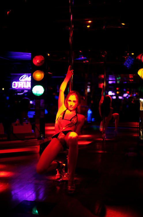 A girl performs a lonely dance at the world famous Mons Venus strip club in Tampa, Florida.