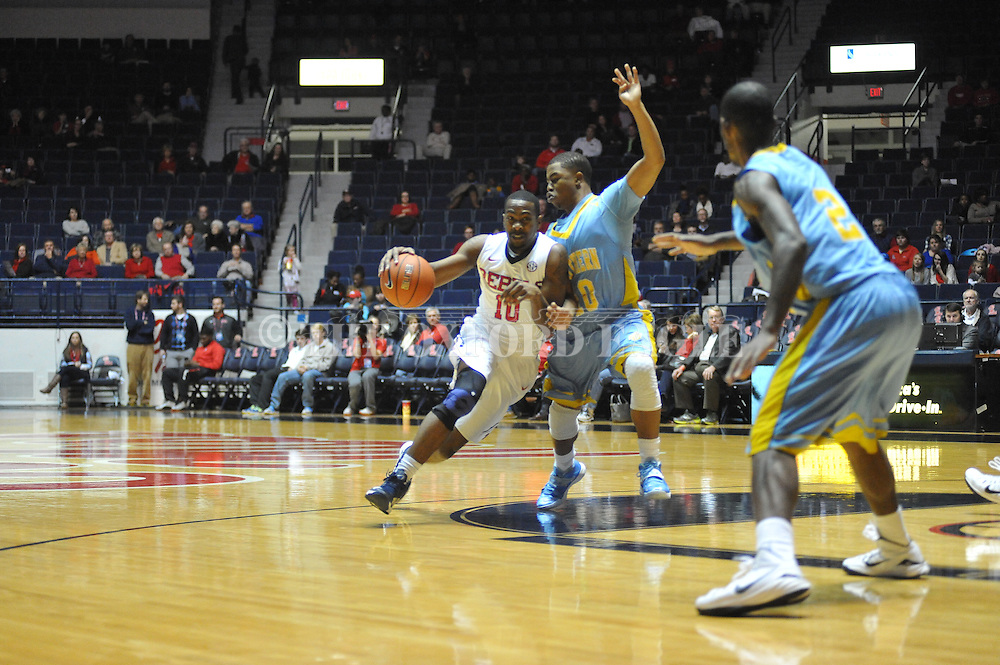 "Ole Miss' guard Ladarius White (10) vs. southern University Jaguars guard Cameron Monroe (10) at the C.M. ""Tad"" Smith Coliseum in Oxford, Miss. on Thursday, November 20, 2014. (AP Photo/Oxford Eagle, Bruce Newman)"