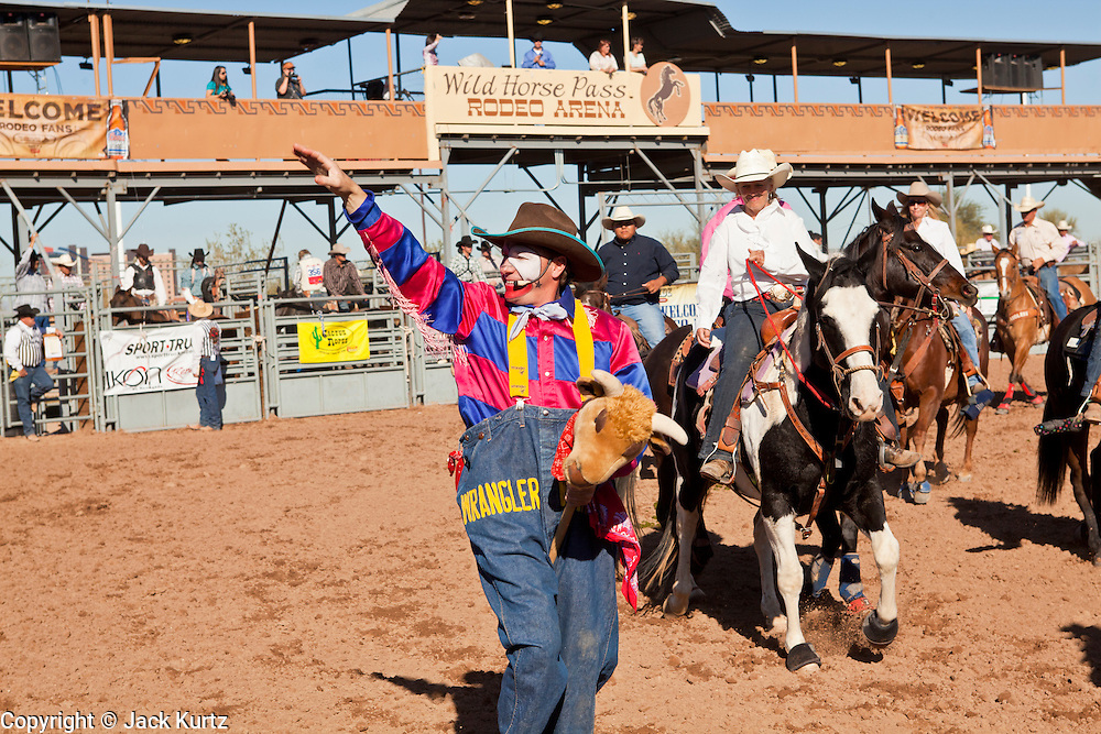 26 NOVEMBER 2011 - CHANDLER, AZ:   The rodeo clown in the grand entry parade at the Grand Canyon Pro Rodeo Association (GCPRA) Finals at Rawhide Western Town in west Chandler, AZ, about 20 miles from Phoenix Saturday. The GCPRA Finals is the last rodeo of the GCPRA season. The GCPRA is a professional rodeo association based in Arizona.     PHOTO BY JACK KURTZ