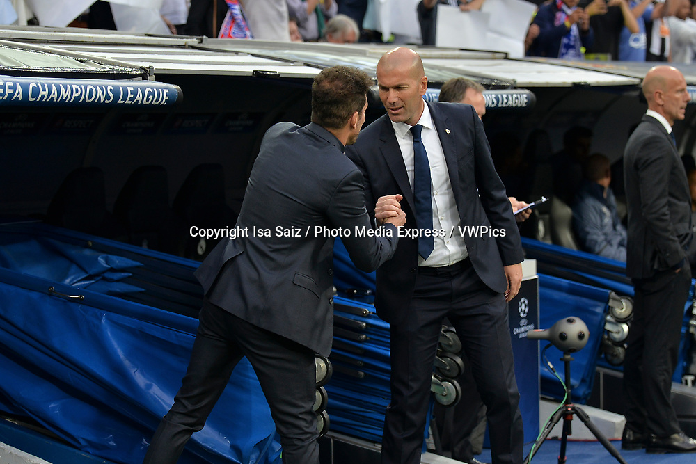 May 2, 2017- Madrid, Spain. Cholo Simeone and Zinedine Zidane before the game starts. UEFA Champions League semi-final first leg. Real Madrid defeated Atletico de Madrid 3-0 with a hat-trick scored by Cristiano Ronaldo (10, 73 and 86 min). Santiago Bernabéu Stadium, Madrid, Spain. Photo by Isa Saiz | PHOTO MEDIA EXPRESS