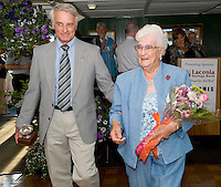 Robert Hamel escorts Gemma Hamel off the stage after she recieved  the 2010 Irwin Award at the Chamber of Commerce 3rd annual Mix 'n Mingle onboard the MS Mount Washington Thursday evening.  (Karen Bobotas/for the Laconia Daily Sun).