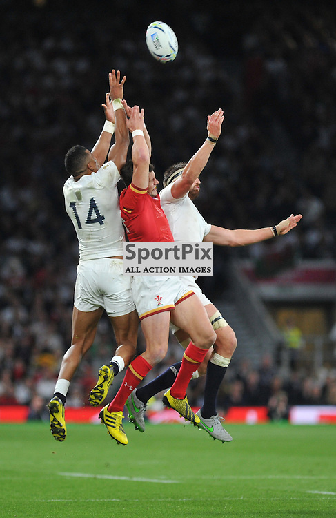 Anthony Watson of England, Hallam Amos of Wales and Tom Wood of England contest a high ball during the IRB RWC 2015 Pool A match between England and Wales at Twickenham Stadium on Saturday 26 September 2015, London, England. (c) Ian Nancollas | SportPix.org.uk