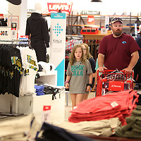 Shoppers stroll through JCPenney shopping for back to school deals during the tax free weekend Friday morning at The Mall at Barnes Crossing in Tupelo.