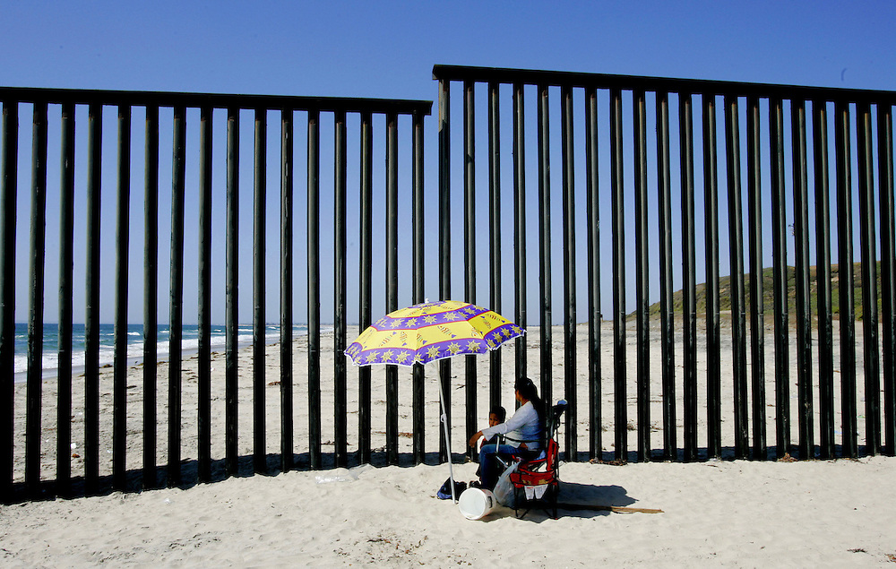 TIJUANA, MEXICO:  Beach-goers with the border wall in back in the Las Playas area of Tijuana, Mexico.