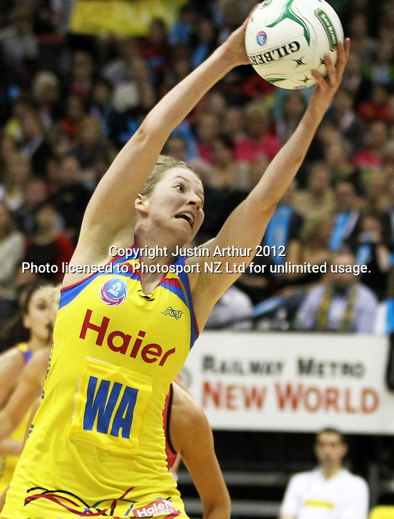 Pulse's Camilla Lees gathers the ball during the ANZ Netball Championship, Haier Pulse v Adelaide Thunderbirds at TSB Bank Arena, Wellington, New Zealand on Monday 21 May 2012. Photo: Justin Arthur / photosport.co.nz