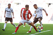 Matt Lowe of Brackley Town (2) and George Porter of Bromley FC (18) in action during the FA Trophy match between Brackley Town and Bromley at Wembley Stadium, London, England on 20 May 2018. Picture by Stephen Wright.