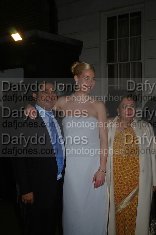 Angad Paul and Michelle Bonn, Lady Paul. Wedding reception of Angad Paul and Michelle Bonn, Lancaster House. St. James. 21 March 2005. ONE TIME USE ONLY - DO NOT ARCHIVE  © Copyright Photograph by Dafydd Jones 66 Stockwell Park Rd. London SW9 0DA Tel 020 7733 0108 www.dafjones.com