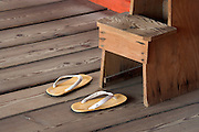 Japanese zori sandals in front of small wooden upstep