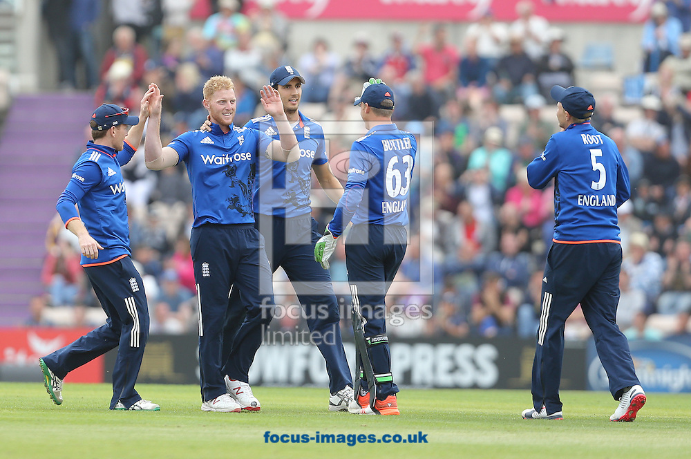 Ben Stokes ( 2nd L ) of England celebrates taking the wicket of Luke Ronchi ( not pictured ) of New Zealand during the Royal London One Day Series match at the Ageas Bowl, West End<br /> Picture by Paul Terry/Focus Images Ltd +44 7545 642257<br /> 14/06/2015