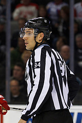 Nov 17, 2011; San Jose, CA, USA; NHL linesman Bryan Pancich (94) before a face off between the San Jose Sharks and the Detroit Red Wings during the first period at HP Pavilion. San Jose defeated Detroit 5-2. Mandatory Credit: Jason O. Watson-US PRESSWIRE