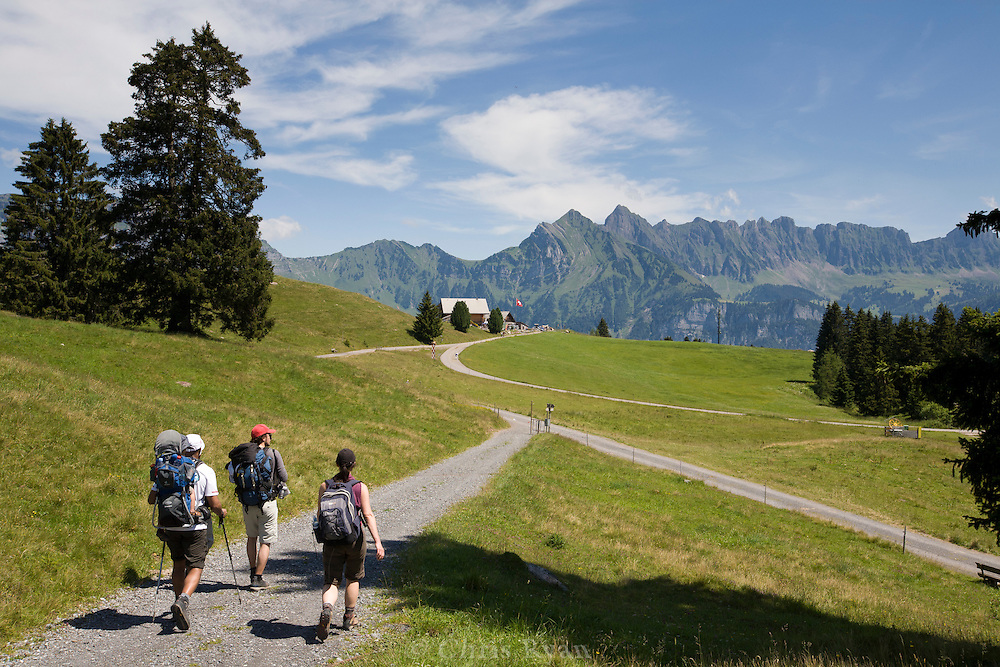 Hut-to-hut hikers in the Swiss Alps, Flumserberg, Sarganserland, Switzerland