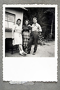 family posing by summer cottage ca 1950s Holland
