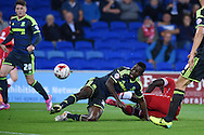 Kenneth Omeruo of Middlesbrough &copy; slides in to deny Kenwyne Jones of Cardiff citySkybet football league championship match, Cardiff city v Middlesbrough at the Cardiff city stadium in Cardiff, South Wales on Tuesday 16th Sept 2014<br /> pic by Andrew Orchard, Andrew Orchard sports photography.