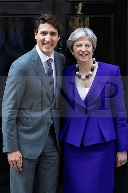 © Licensed to London News Pictures. 18/04/2018. London, UK. Prime Minister of Canada Justin Trudeau (L) and Prime Minister Theresa May (R) greet each other outside 10 Downing Street. Photo credit: Rob Pinney/LNP