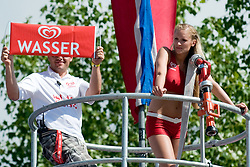 "Eskimo girl and fireman with sign ""Wasser"" at A1 Beach Volleyball Grand Slam tournament of Swatch FIVB World Tour 2010, final, on July 31, 2010 in Klagenfurt, Austria. (Photo by Matic Klansek Velej / Sportida)"