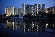 Anseong/South Korea, Republic of Korea, KOR,27.04.2009: High-rise buildings mirrored in a rice field located in Anseong about 80 Km from Seoul. Anseong/Suedkorea, Republik Korea, KOR, 27.04.2009: Hochhaeuser gespiegelt in einem Reisfeld in der Naehe von Anseong - ung. 80 Km von Seoul gelegen.