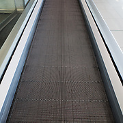 A moving walkway in an airport, designed to speed up pedestrian traffic between departure gates.