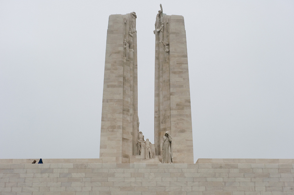 Thefront side of the ‪Canadian National Vimy Memorial‬ dedicated to the memory of Canadian Expeditionary Force members killed in World War one. The monument is situated at a 100 hectare preserved battlefield with wartime tunnels, trenches, craters and unexploded munitions. The memorial designed by Walter Seymour Allward opened in 1936.
