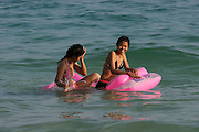 Hat Sai Kaew. Girls with pink air matress.