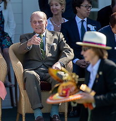The Duke of Edinburgh watches a procession of carriage drivers during the polo at the Guards Polo Club, Windsor Great Park, Egham, Surrey.