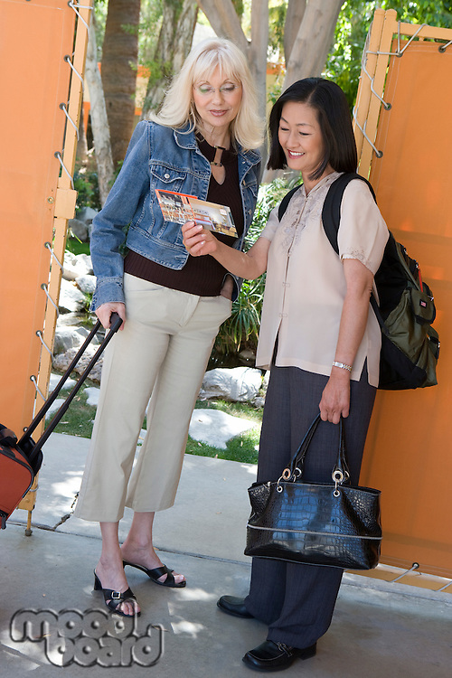 Two women with luggage on vacation