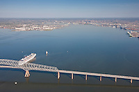 Aerial of Carnival Pride Cruise Ship sailing by Key Bridge toward the Baltimore Harbor