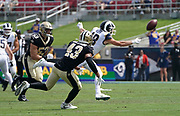 Los Angeles Rams wide receiver Cooper Kupp (18) attempts to catch the ball while New Orleans Saints free safety Marcus Williams (43) defends during an NFL football game, Sunday, Sept. 15, 2019, in Los Angeles. The Rams defeated the Saints 27-9. (Dylan Stewart/Image of Sport)