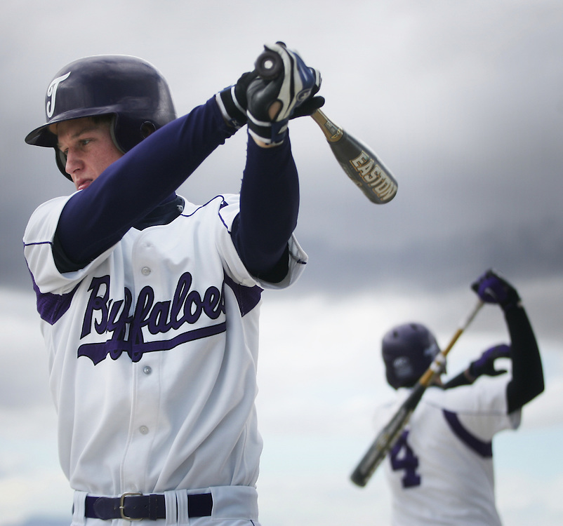 photography / Troy Boman.Zac Clausing  warms up with Steven Witkowski (right) before playing Davis. The Buffalos lost to the Darts 9-3. Tooele High will play their next four games at home facing Grantsville today and double header with Highland on Wednesday.
