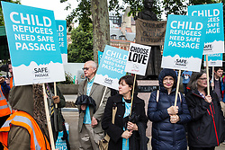 London, UK. 18 June, 2019. Campaigners with placards attend a demonstration in Parliament Square to demand that the Government resettle 10,000 unaccompanied refugee children over 10 years. As part of Lord Dubs' 'Our Turn' campaign, councils around the UK have already pledged places for over 1,100 children if the Government should make a new resettlement commitment.
